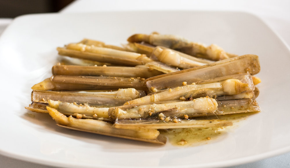Small razor clams (canyuts) with almonds