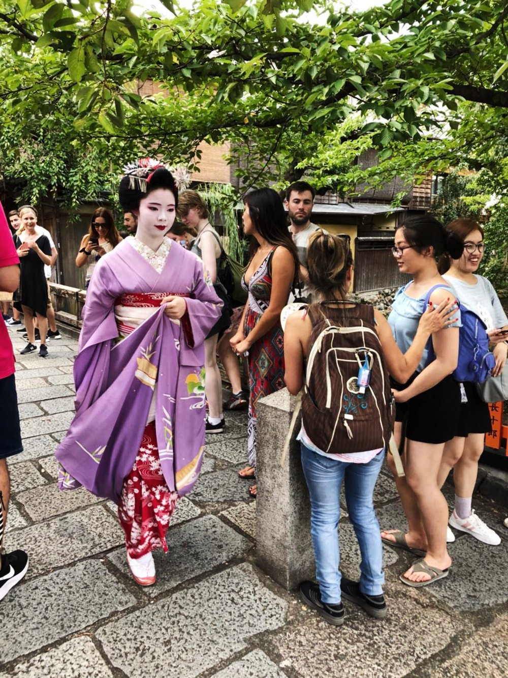 A trainee geisha, called a Maiko, hurrying to her appointment in Gion, Kyoto