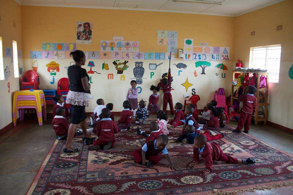 Wassisi (teacher) with the youngest class : ages 3-5yrs