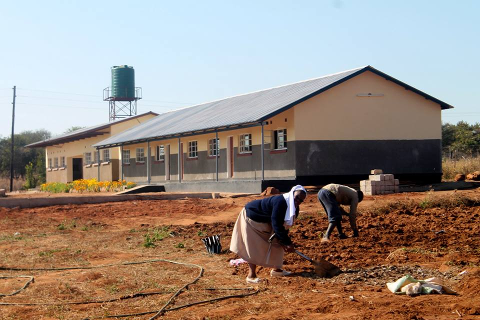 St Crystetta hard at work in the school's vegetable patch