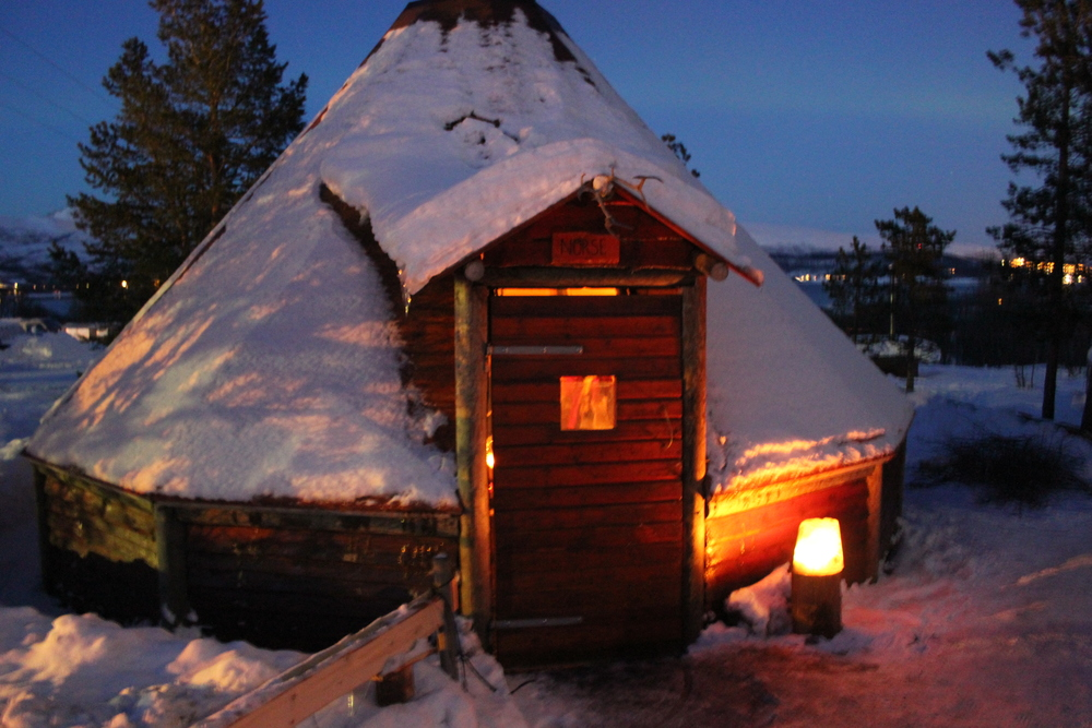 Warm up in the hut before and after your dog sledding adventure