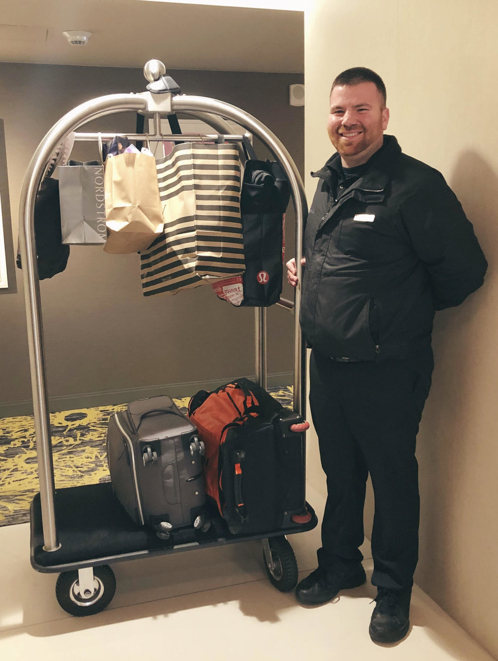 So much luggage but still a friendly smile! - Archer Hotel Austin