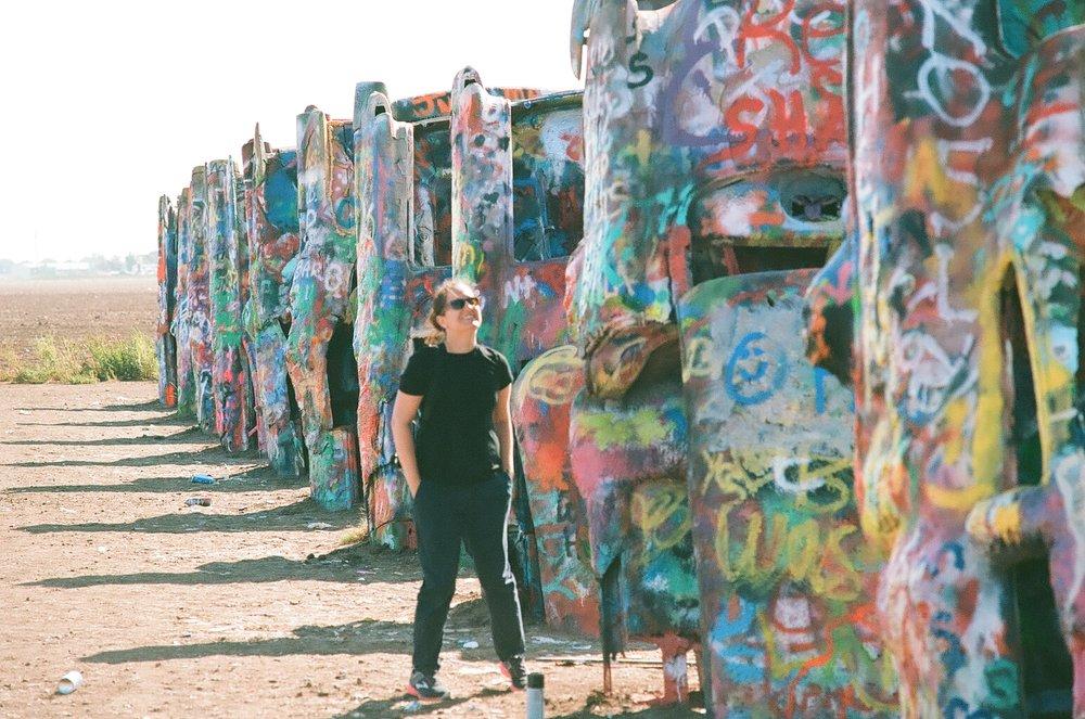 Michelle in New Mexico next to some graffiti art.