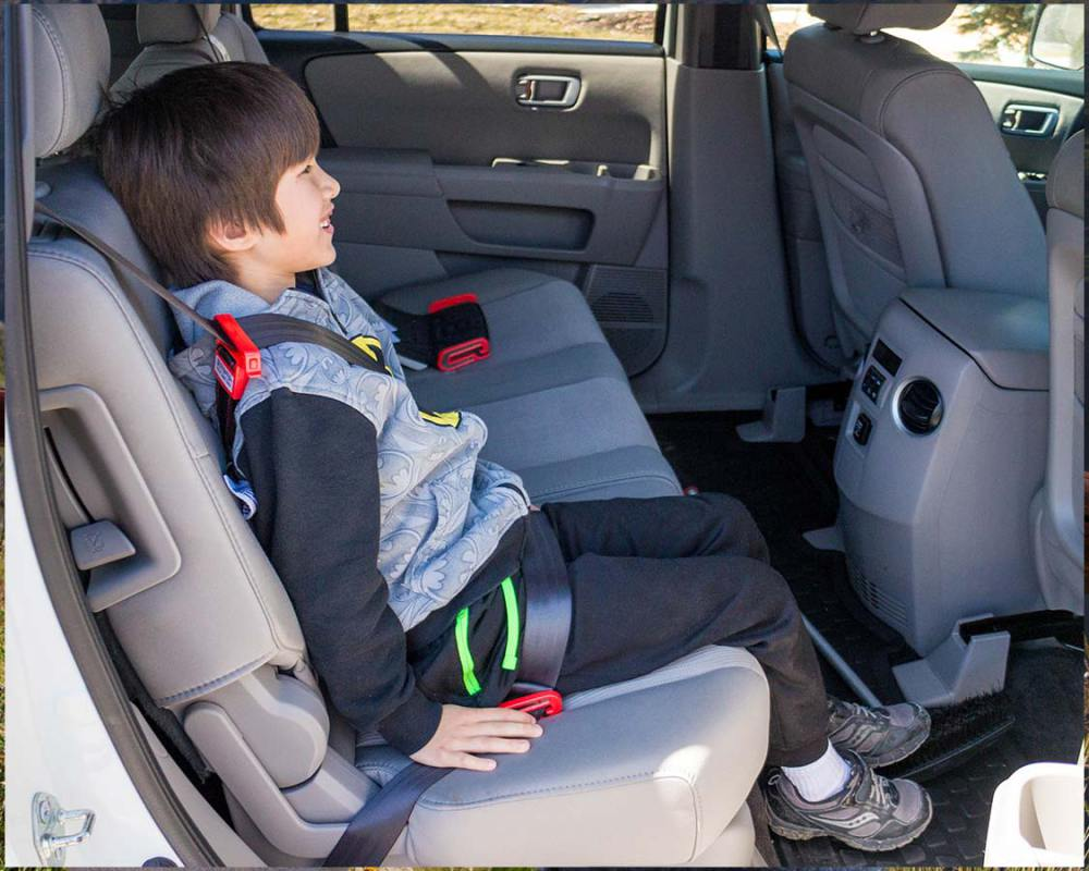 There have been comments that the MiFold can latch the belt too low on the legs or hip of the child. The lap belt should fit flat and snugly across the hip and upper legs. While we haven't experienced this ourselves, it is important to make sure that the car seat is positioned properly for maximum safety and comfort.