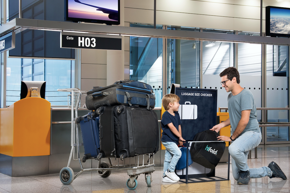 father_and_son_with_hifold_luggage_checker_with_background_jpg.png