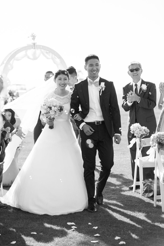 bride-groom-exit-monterey-wedding.jpg