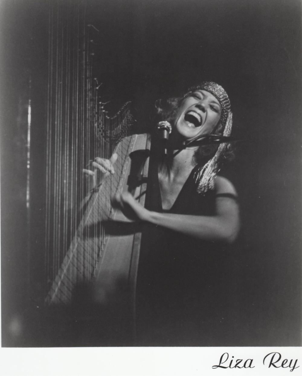 Liza Rey singing.jpg