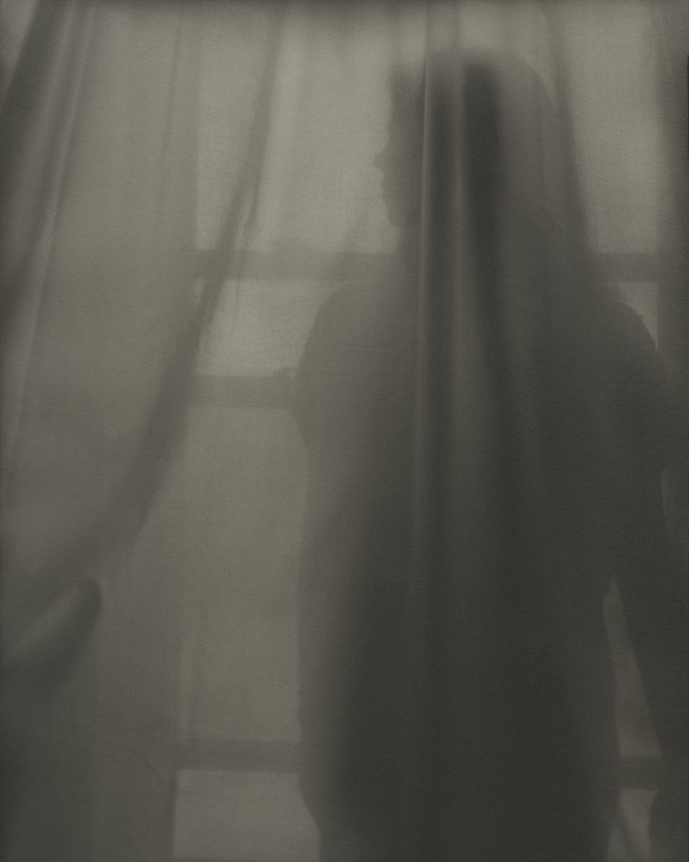 Sofi Behind Curtain