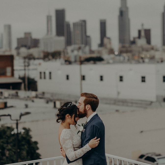 Lisa + Kyle on the rooftop at the Unique Space. Loooove that DTLA skyline! Photo by  Isaiah + Taylor