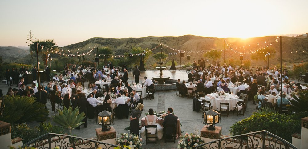 Jessica + Michael's wedding at Hummingbird Nest Ranch. Photo by  OneLove .