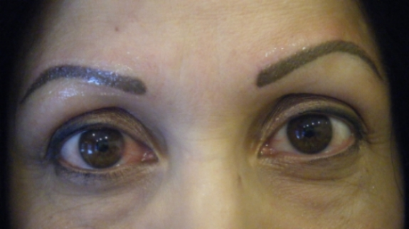 The above photo shows the new brow design post healed removal. the client was forced to pencil her brows for 3 months after the removal to ensure proper healing of the skin before new eyebrows could be applied.