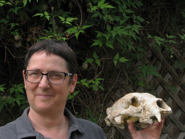 Liz likes bones, too.  Here she is with a bear skull.