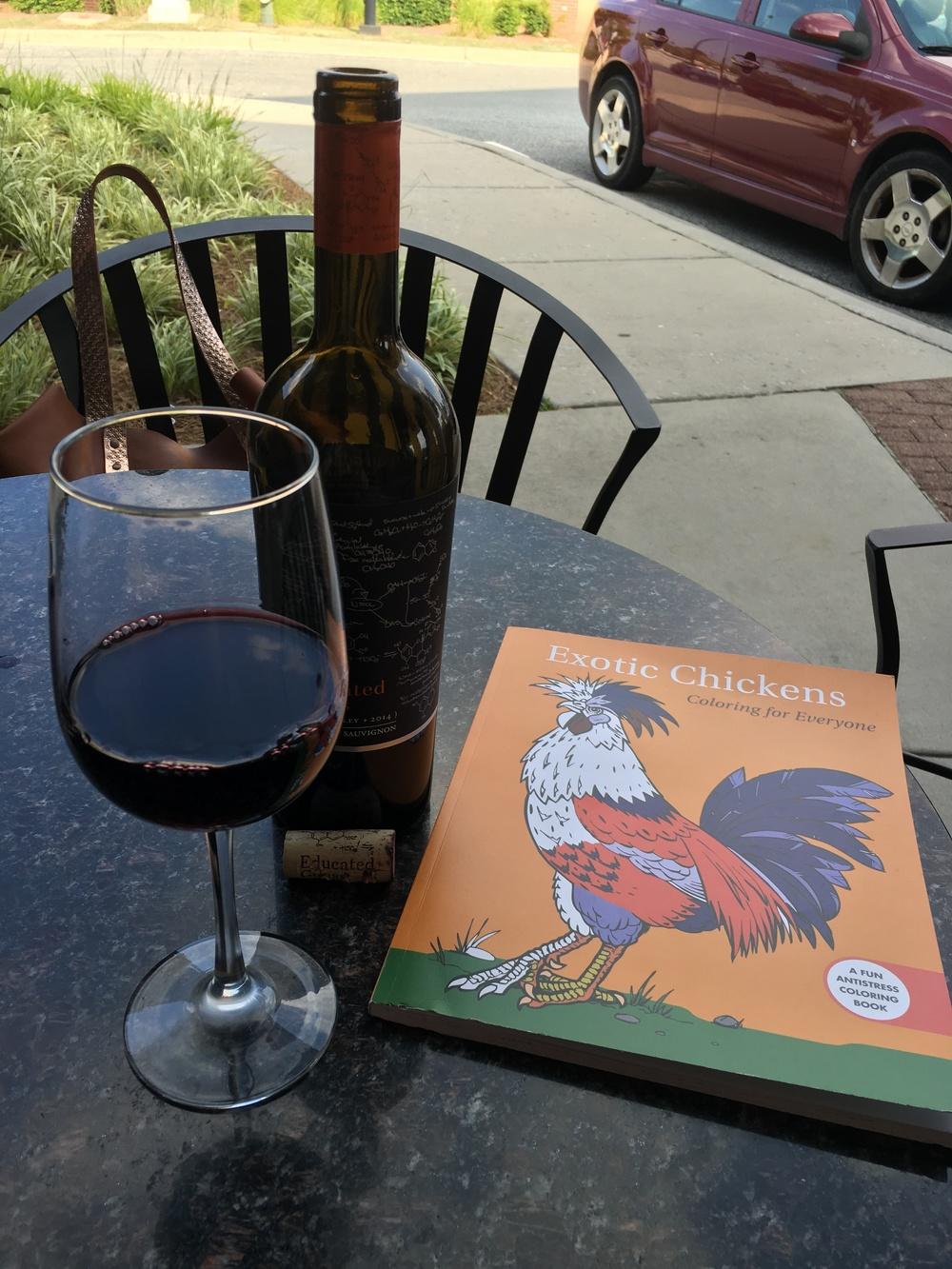 Good wine and a chicken coloring book. All on a lovely Summer afternoon.