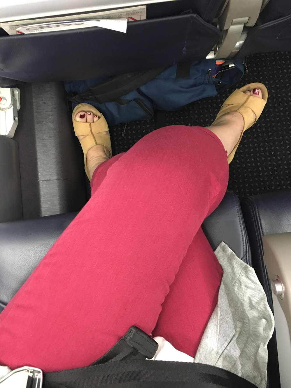 My legs, crossed, with room to spare while I sat in an airline seat. Victory!