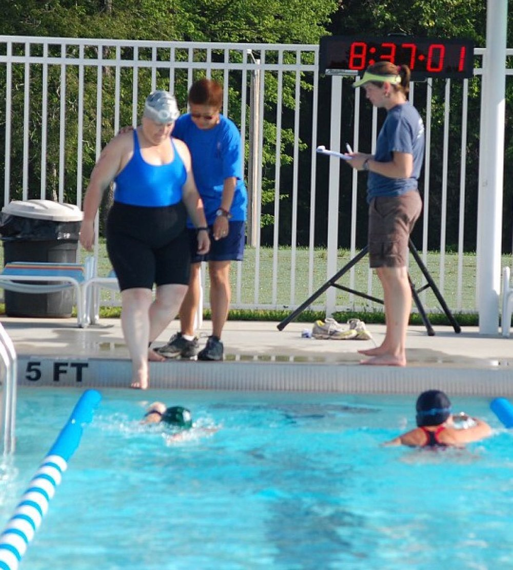 Me, gingerly entering the pool on the first leg of my first triathlon. Yikes.....