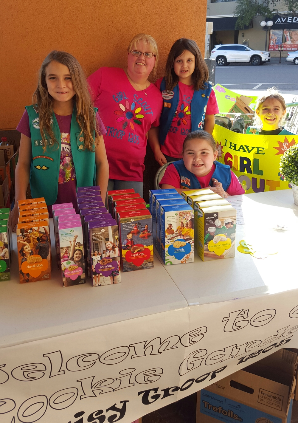 Anna (left, age 9) helped her sister, Kate (right, holding sign, age 6) at her first Girl Scout cookie booth. The troop will use a portion of their sales for community service. Anna's troop has been helping Pack a Sack and Kate's troop has been helping the Ronald McDonald House.