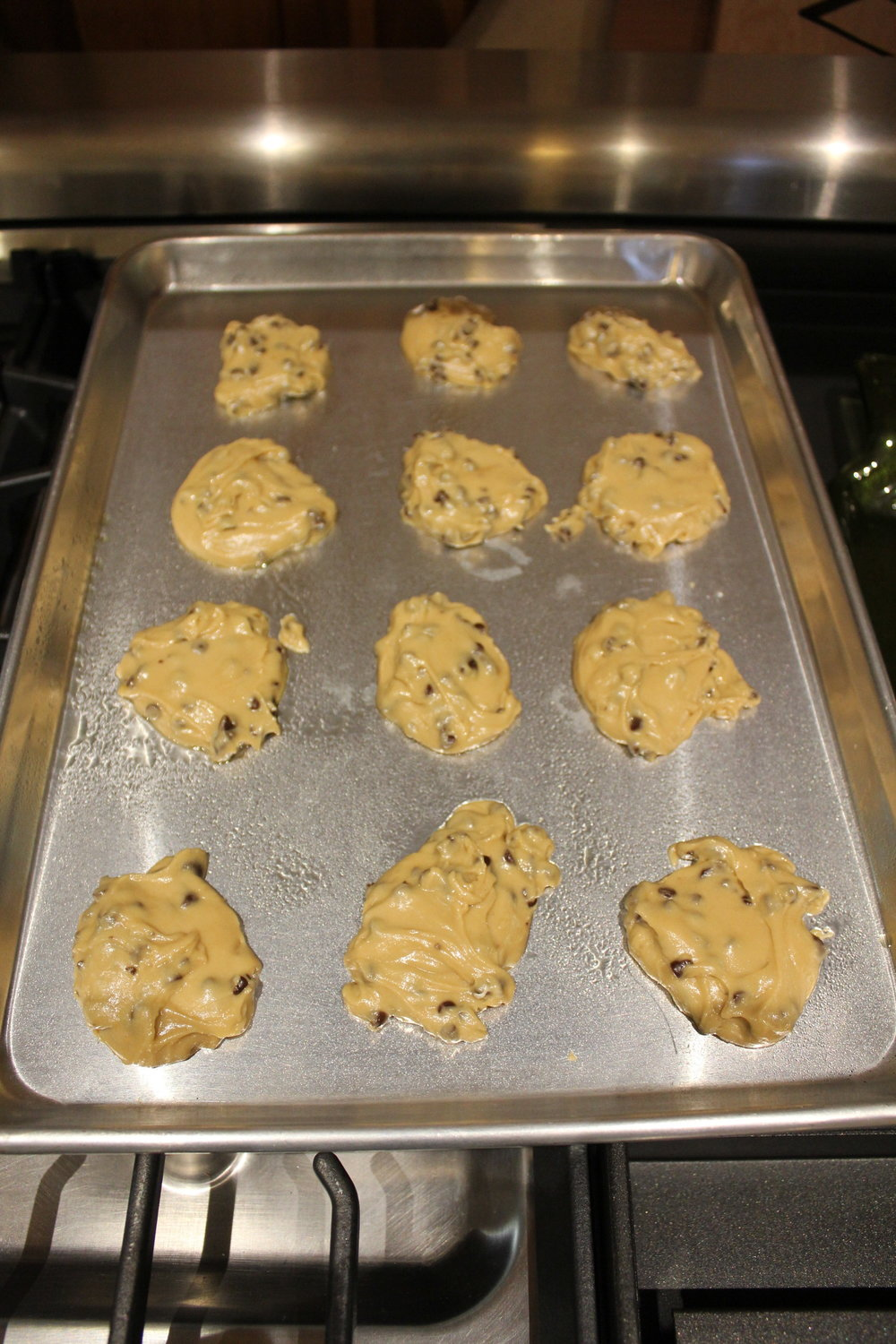 "Despite all the ""helpers"" in the kitchen, some batter actually made it onto the cookie sheets."