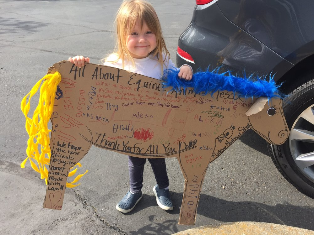 Look at that sign from her school! Addie kept asking if it would scare the horses. It actually spooked one of them!