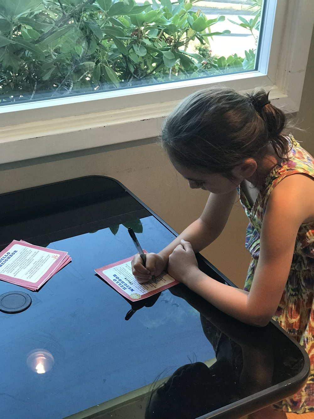 My older daughter filling out our flyers
