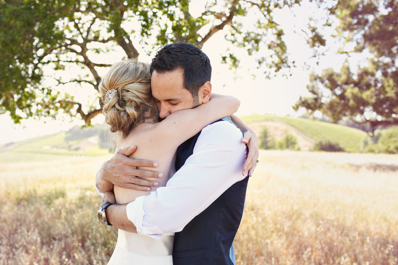 Hugging in winery field