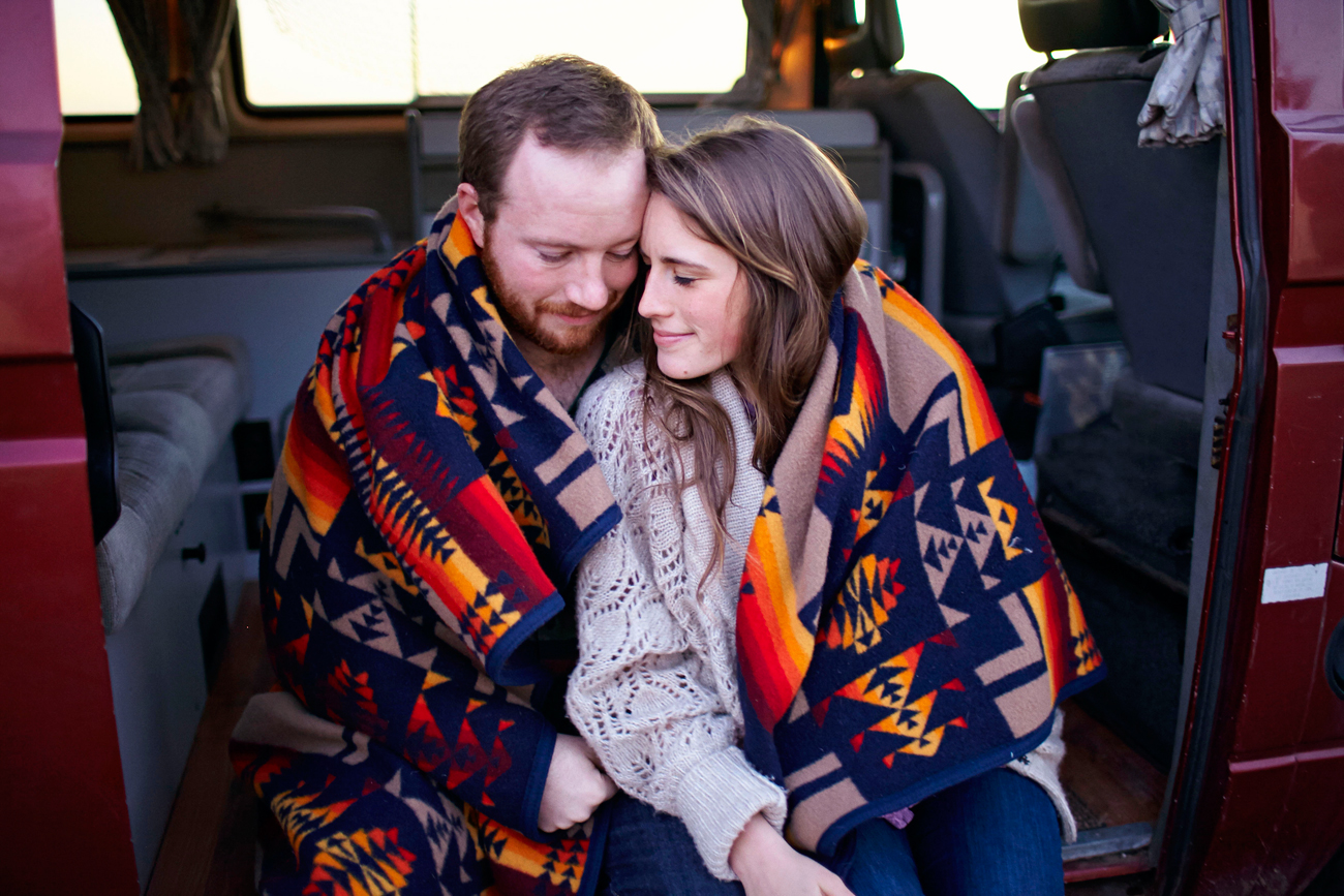 Road trip engagement wrapped in Pendleton blanket
