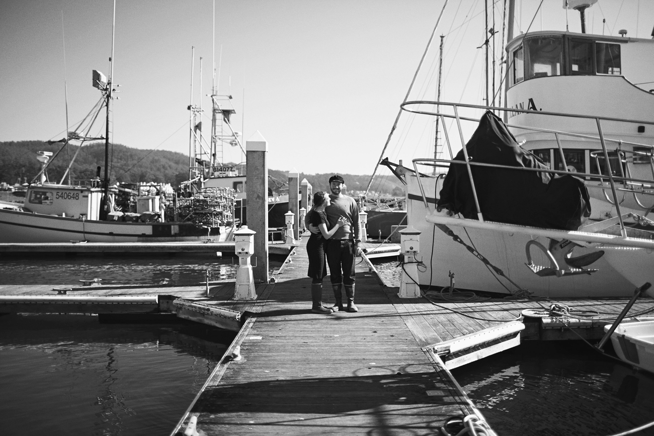 Road trip engagement hugging on the docks