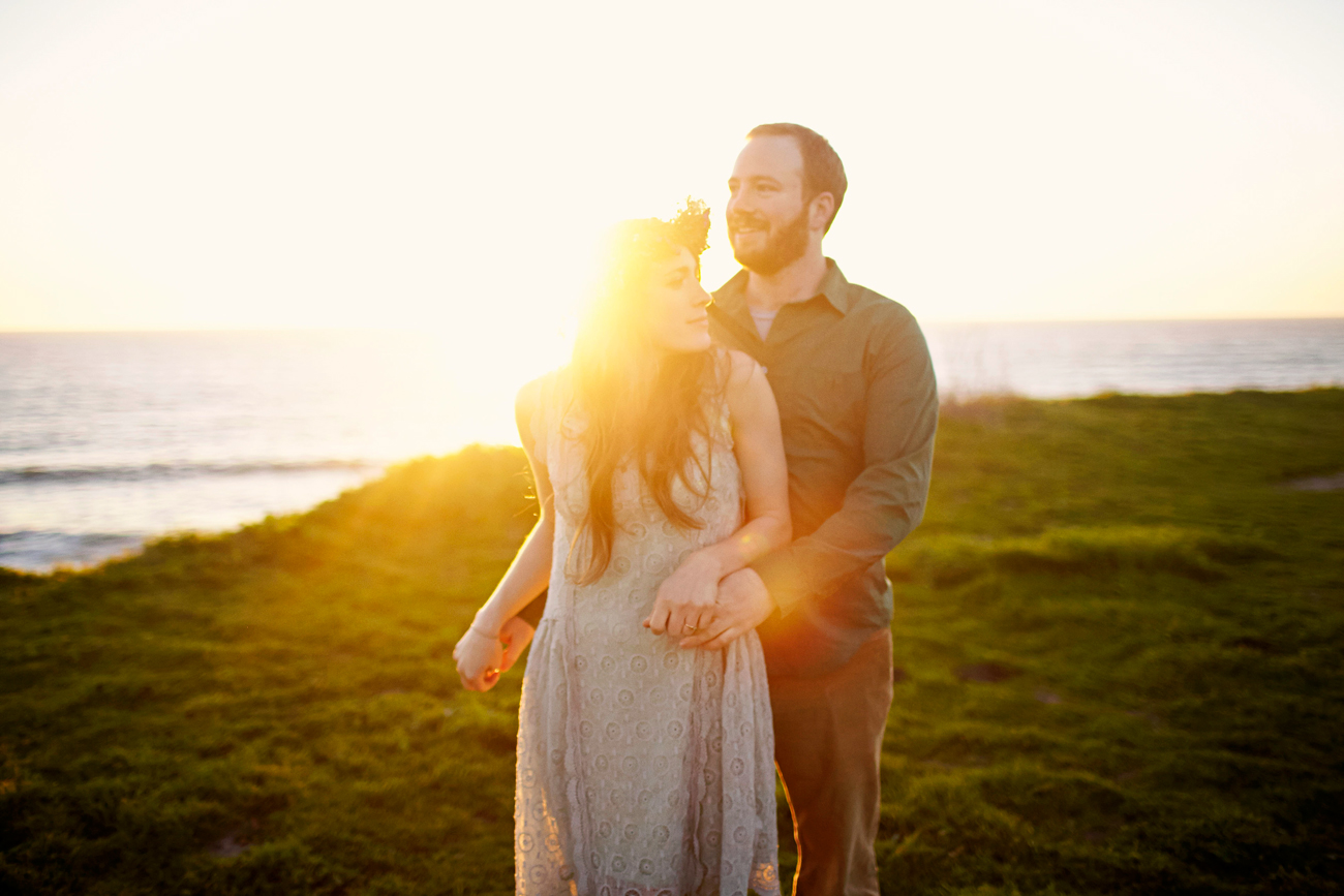 Road trip engagement hugging with flower crown at sunset