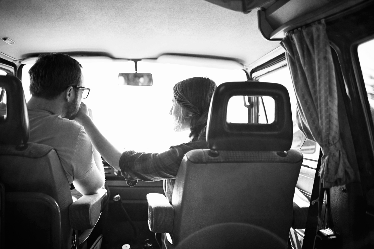 Road trip engagement holding hands in van