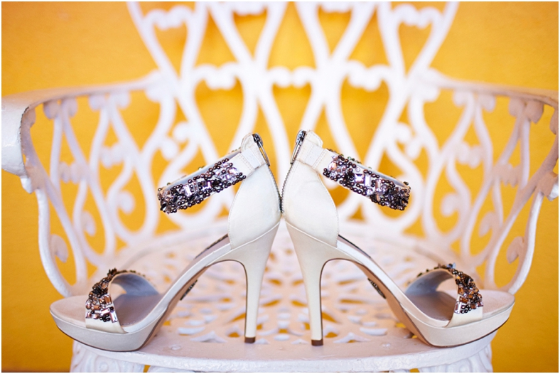 Mexico wedding, shoes against yellow wall