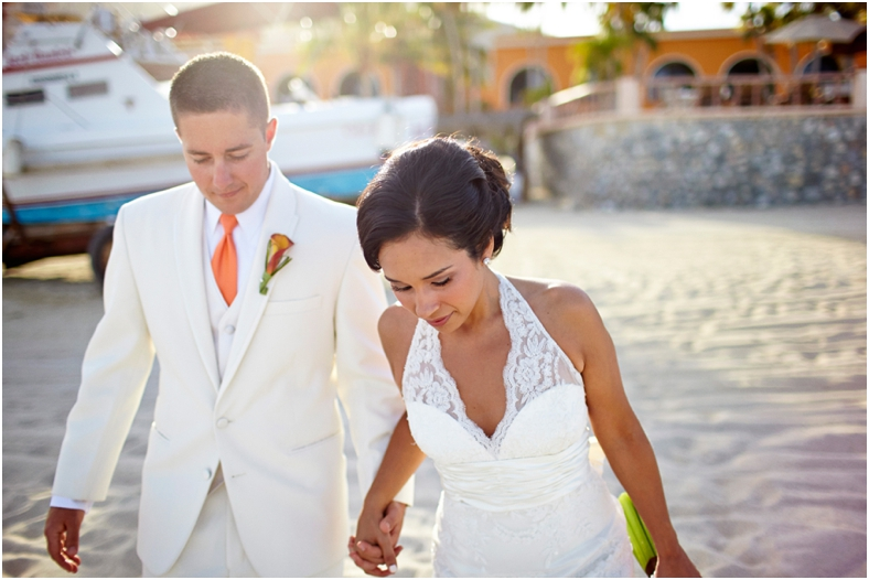 Mexico wedding bride and groom on beach walking