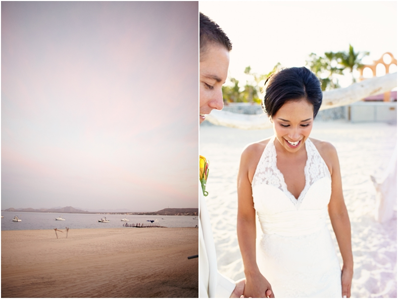 Bride and groom on beach at sunset with boats