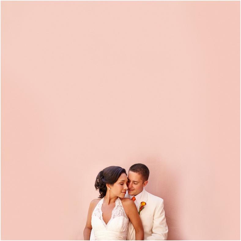 Mexico wedding, Rhea & Rio against pink wall