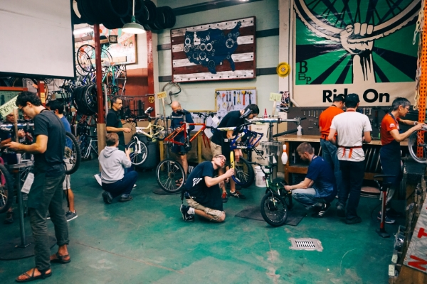 Volunteer mechanics rocking on some kids bikes at Volunteer Night (Tue. & Thur., 6-8pm).