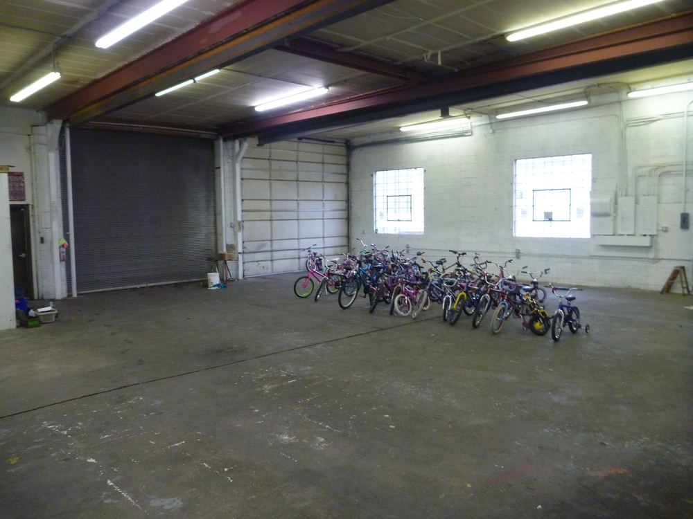 Saturday Afternoon: An (almost) Empty Room!  387 bikes gone to new homes.