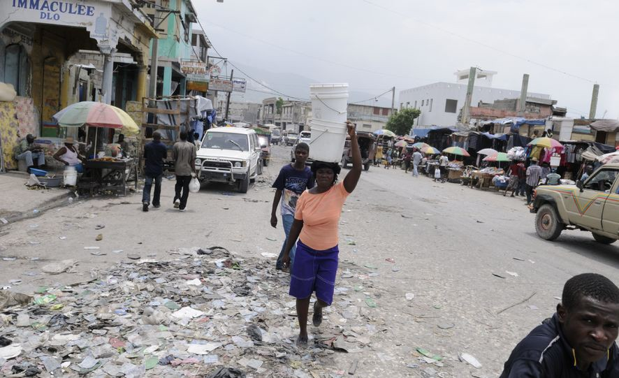 Life goes on, on the streets of Iron Market in Port-Au-Prince, Haiti