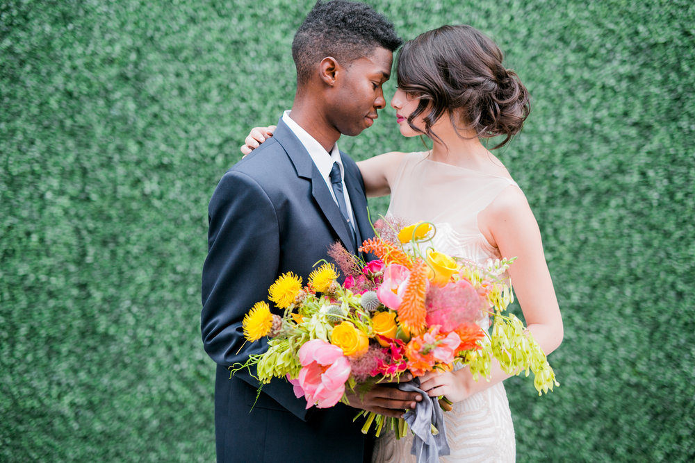 photo: Ashley Rae Photography / floral & styling: Noir / hair: Chelsea Sprinkle / makeup: Bryanna Casey / models: Calista Cruz & Erick Lashley / dress: Mignonette Bridal / suit: Mr. Formal AZ / venue: Events on Jackson