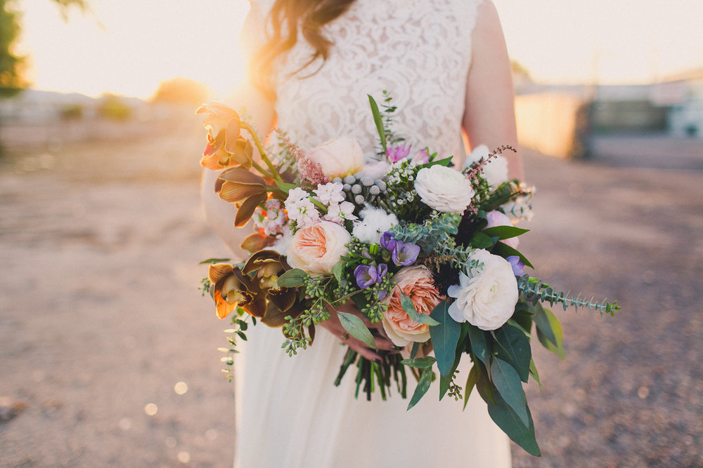Monica's bouquet featured three varieties of eucalyptus - image by Mike Olbinski