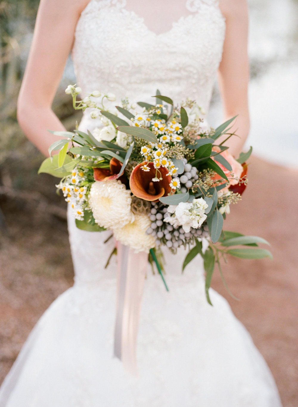 Chelsea's bouquet featured a mix of eucalyptus and bay leaves