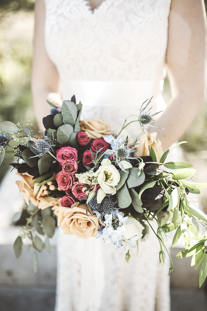 Classic Bouquet - $150 - This bouquet is perfect for brides and bridesmaids alike. This bouquet is perfect for ladies looking for only a few luxurious blooms, a medium sized arrangement, or a design that is an even mix of foliage and flowers.