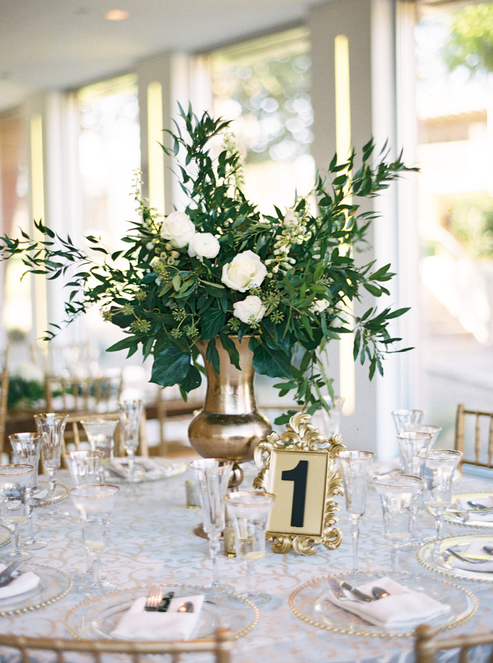 brass-white-tall-wedding-centerpiece.jpg