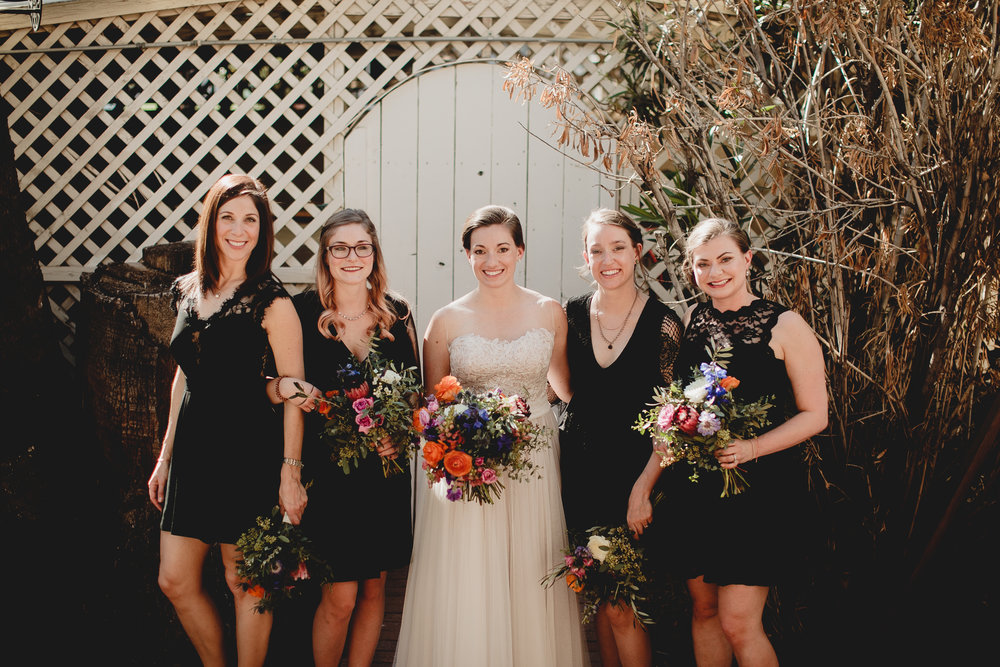 Our bride is carrying a full bouquet and her bridesmaids each had minimal bouquets.