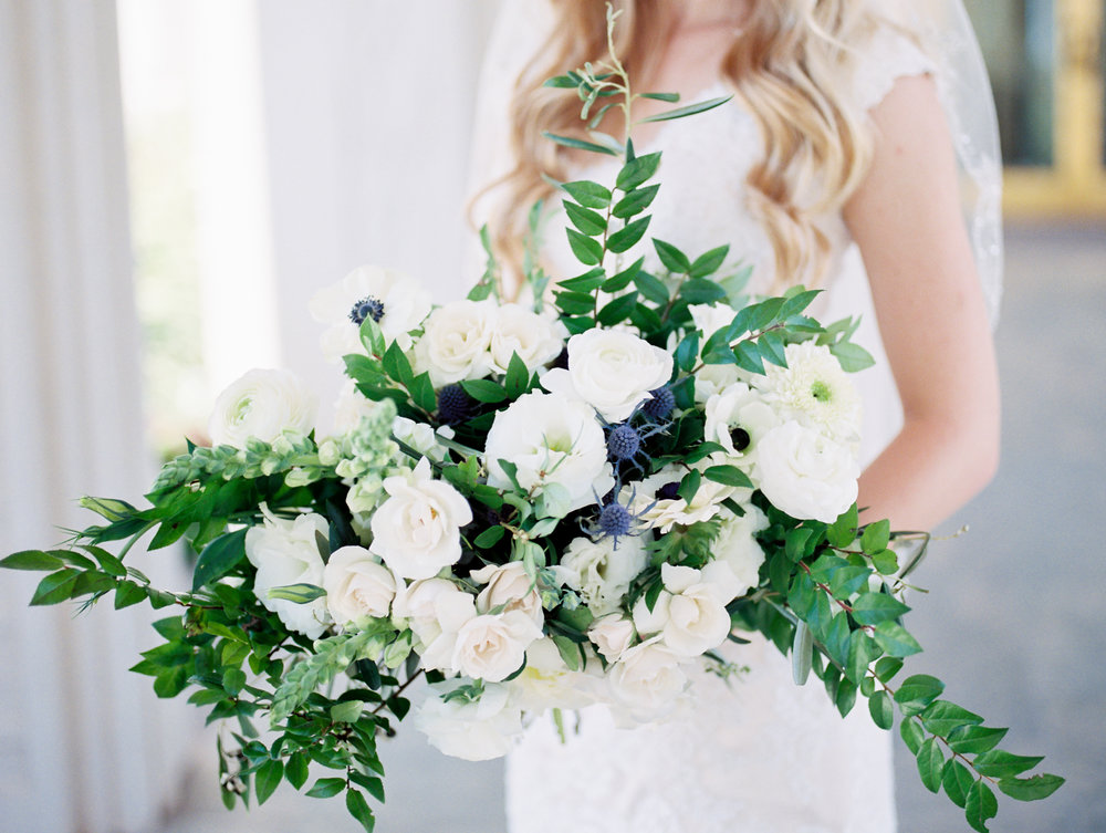 A full bouquet with a white and cream color palette for this gorgeous Peoria wedding.