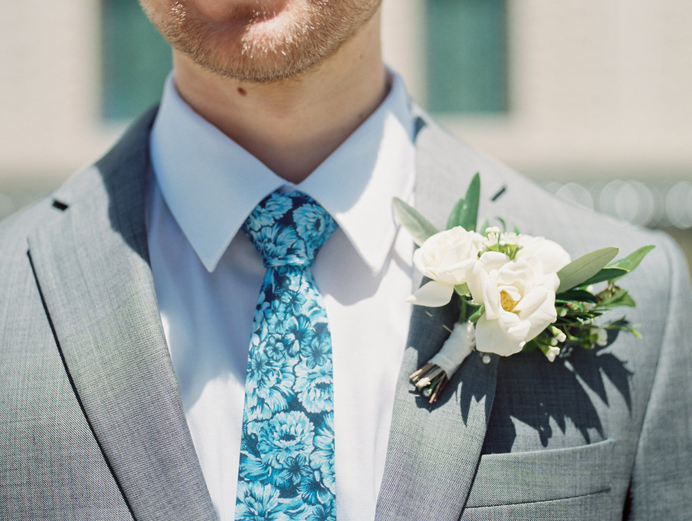 A springtime boutonniere in a white and cream color palette.