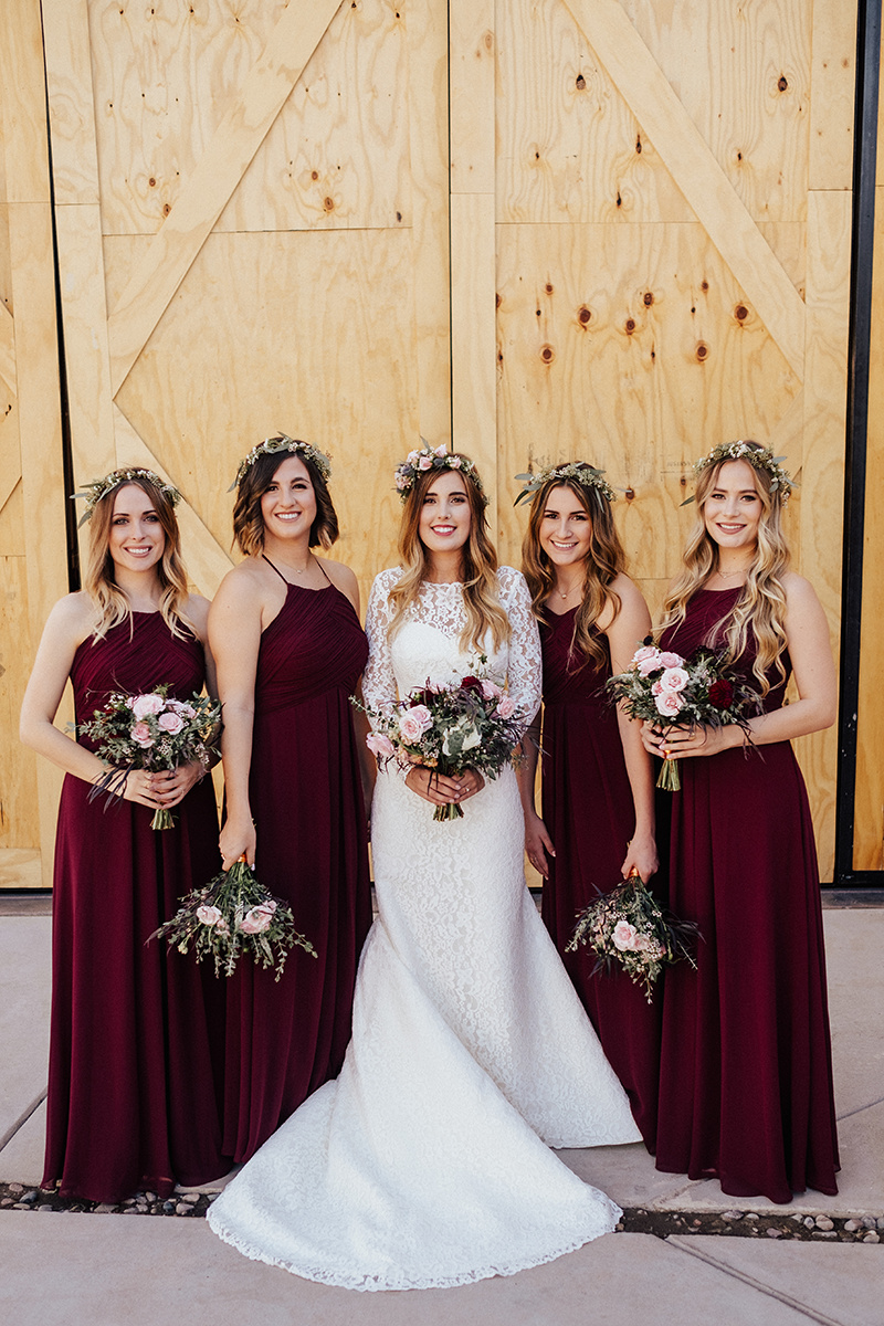 This lovely bride opted to carry a classic bouquet and chose minimal bouquets for her bridesmaids.