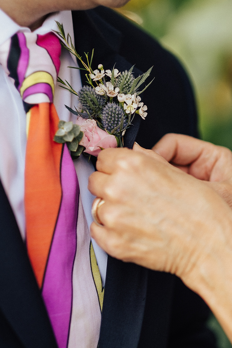 A fun and funky boutonniere in action.