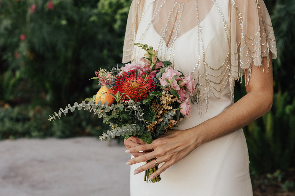 Marcella carried a minimal bouquet with a LOT of personality down the aisle.