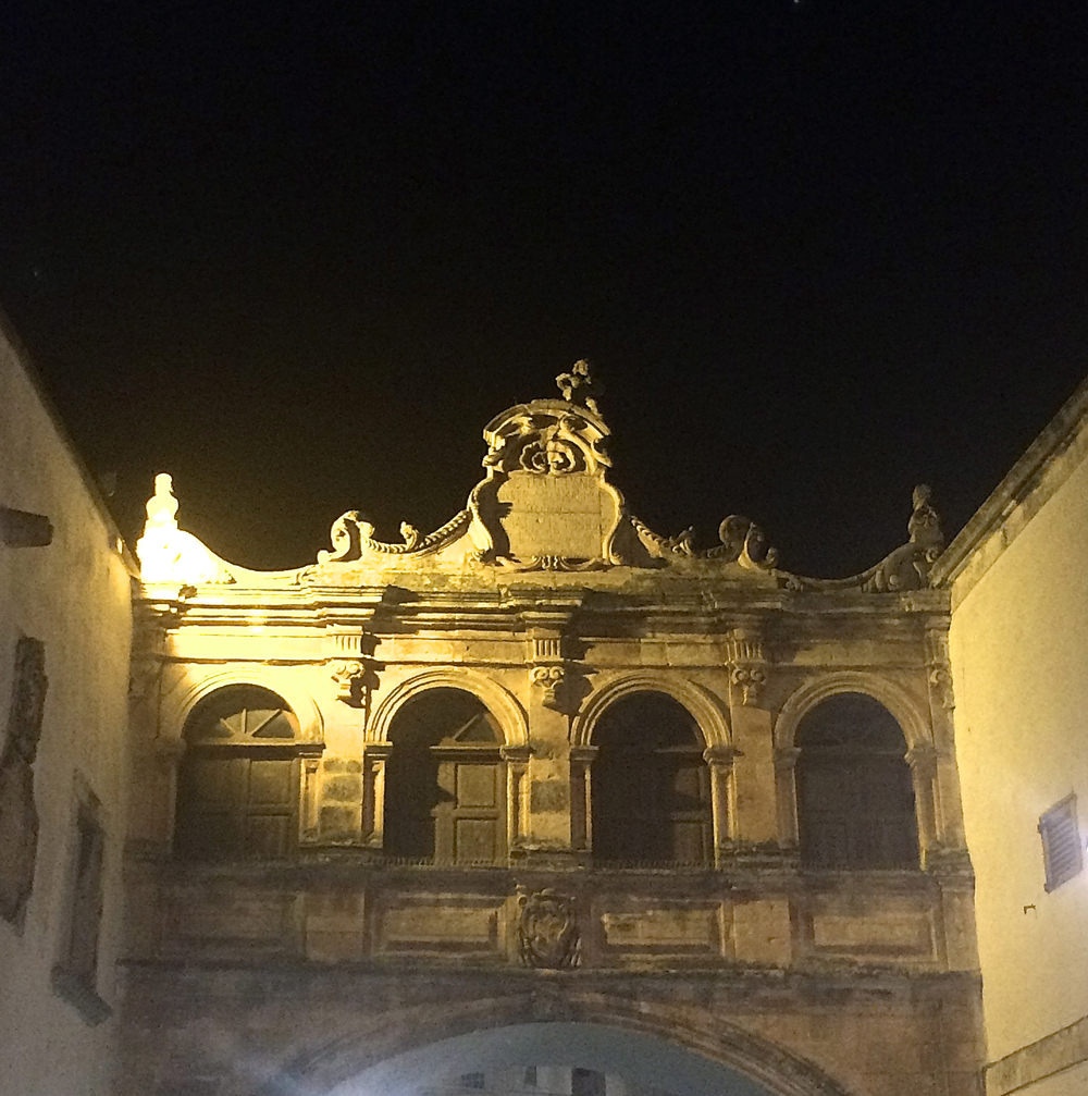 Ostuni by night: gate just in front of Cathedral of Santa Maria dell'Assunzione , up the hill of old town.