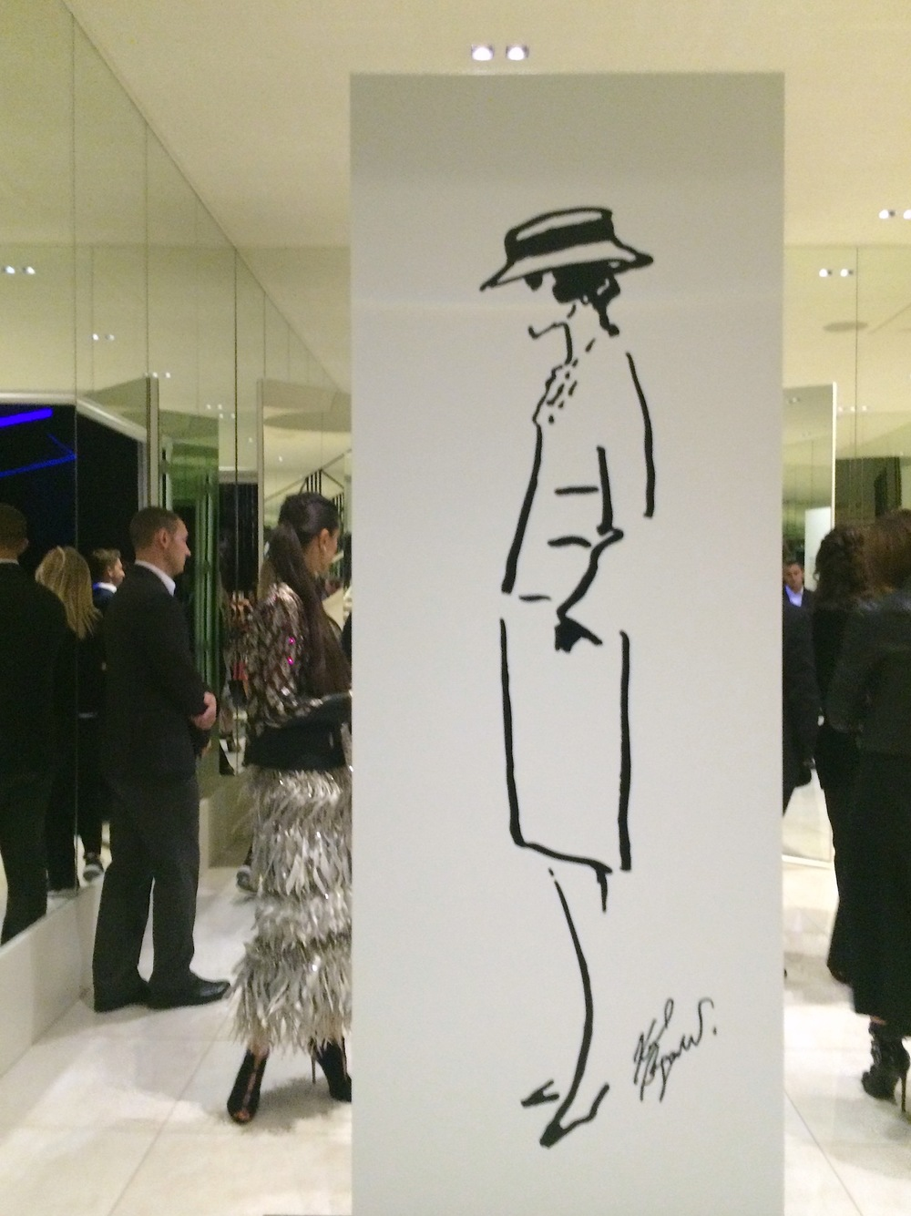 "Eternal ""Mademoiselle"" in her suit and canotier hat, immortalized by Karl Lagerfeld."