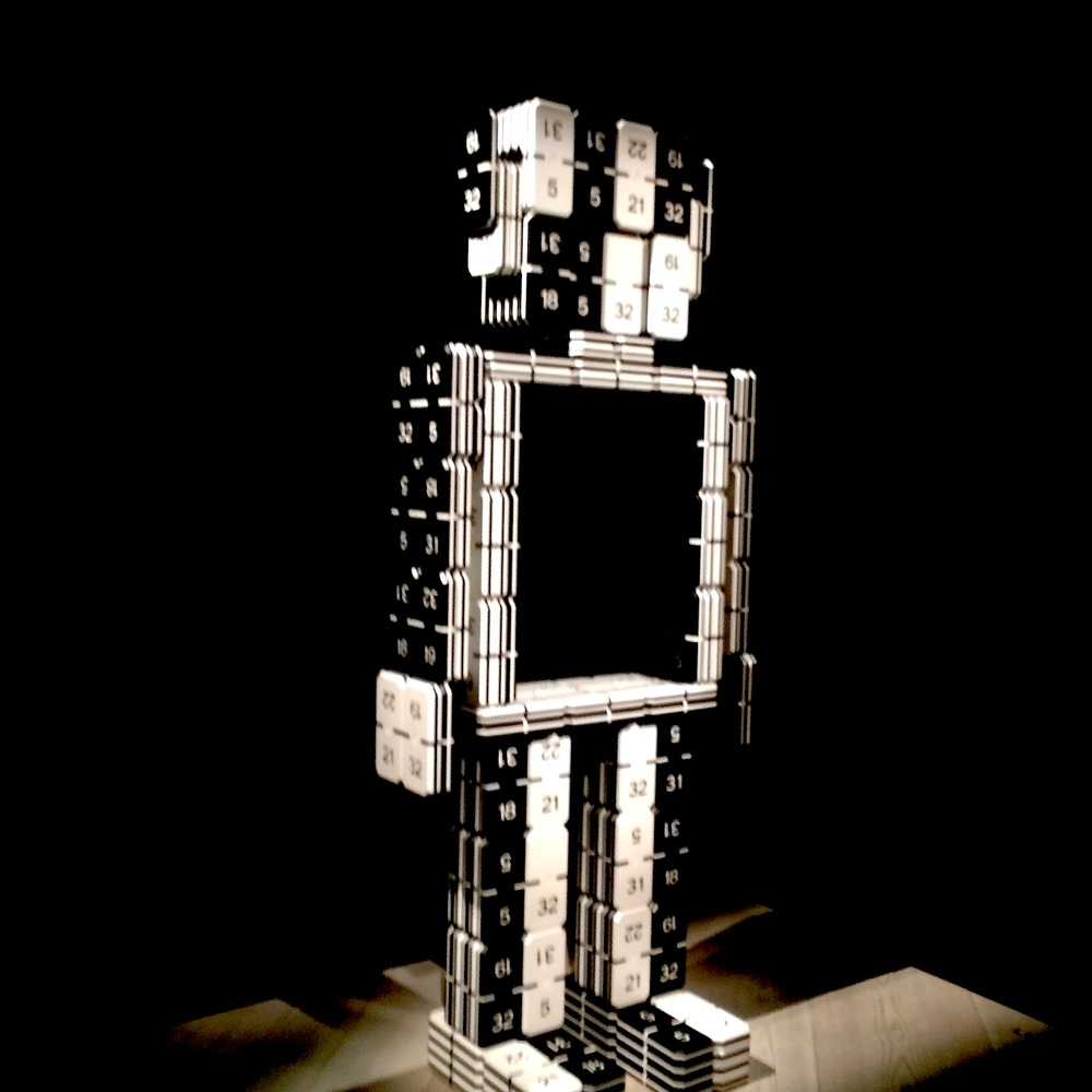 "One of ""totems"", based on several key words of Coco Chanel's life and creation. Here, a robot is made of dices which carry her lucky numbers such as 5, 19, 21…."