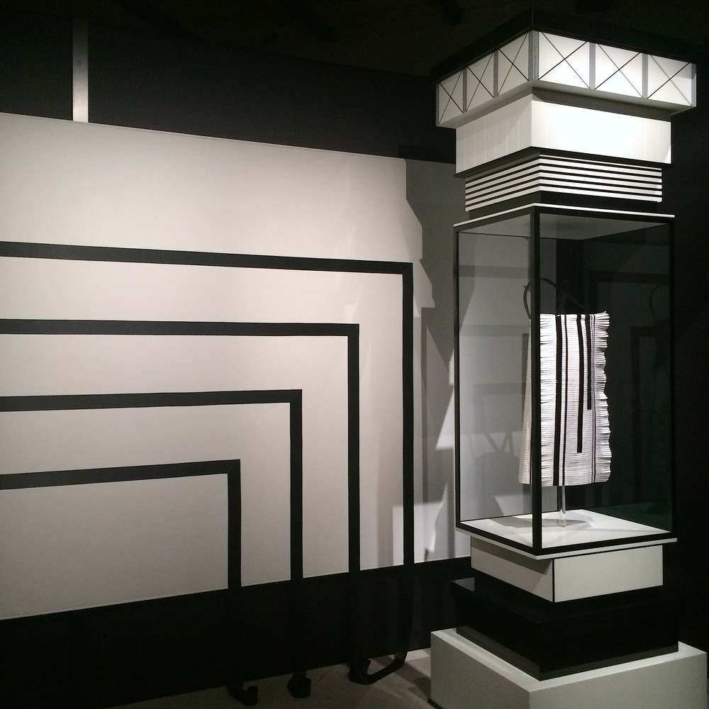 Black lines against white are everywhere at the exhibition, as if we walk inside in Chanel's packaging or shopping bag.